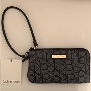 Brand new Calvin Klein black logo wristlet! 🔥